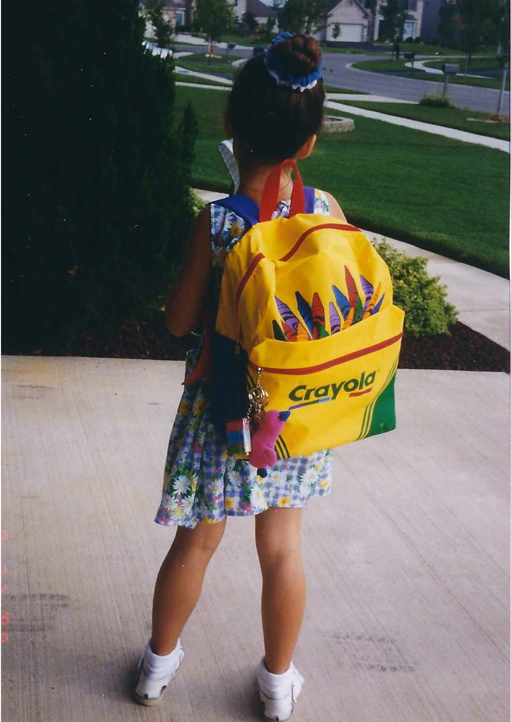 girl with crayon backpack