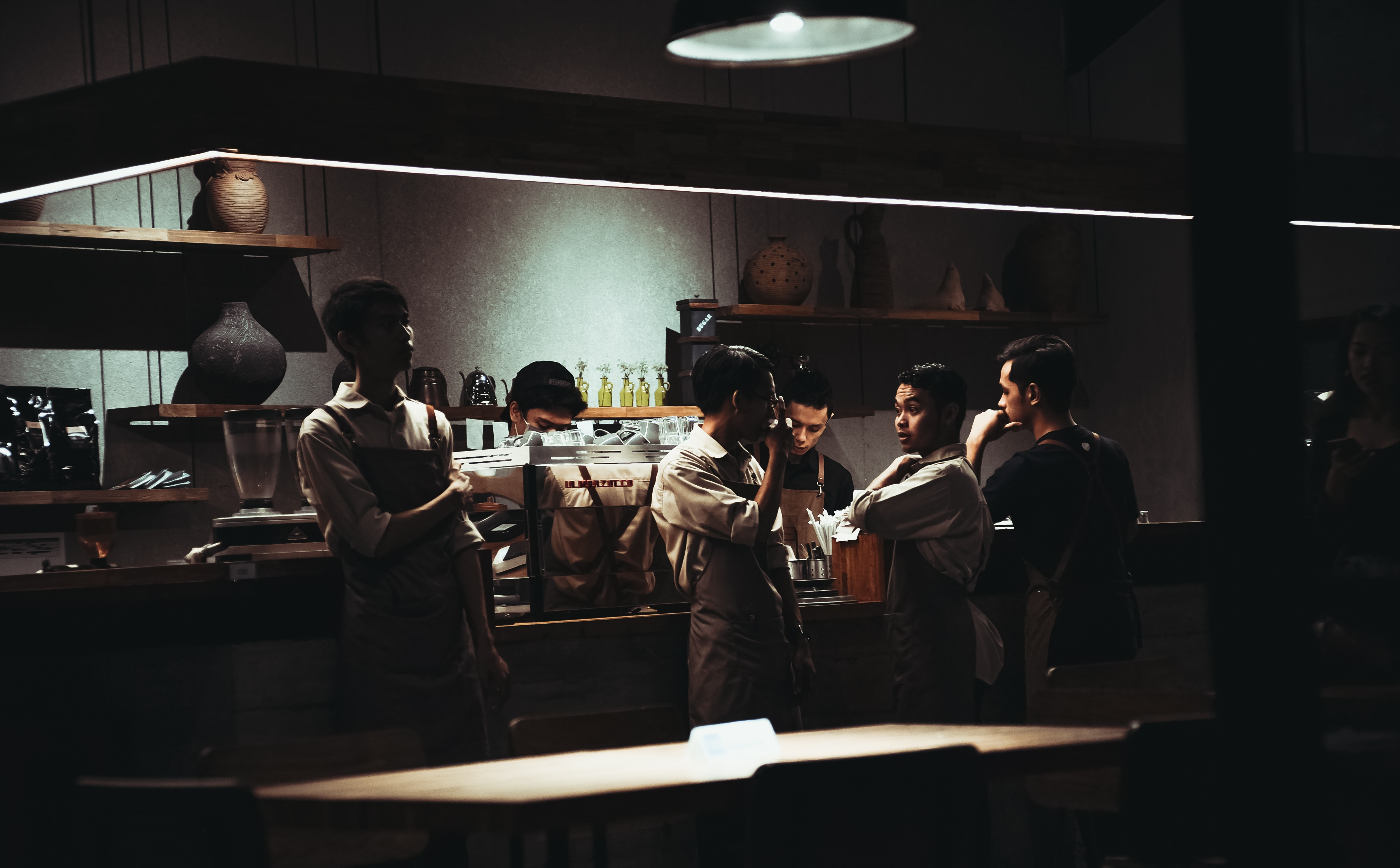 people crowded around a kitchen