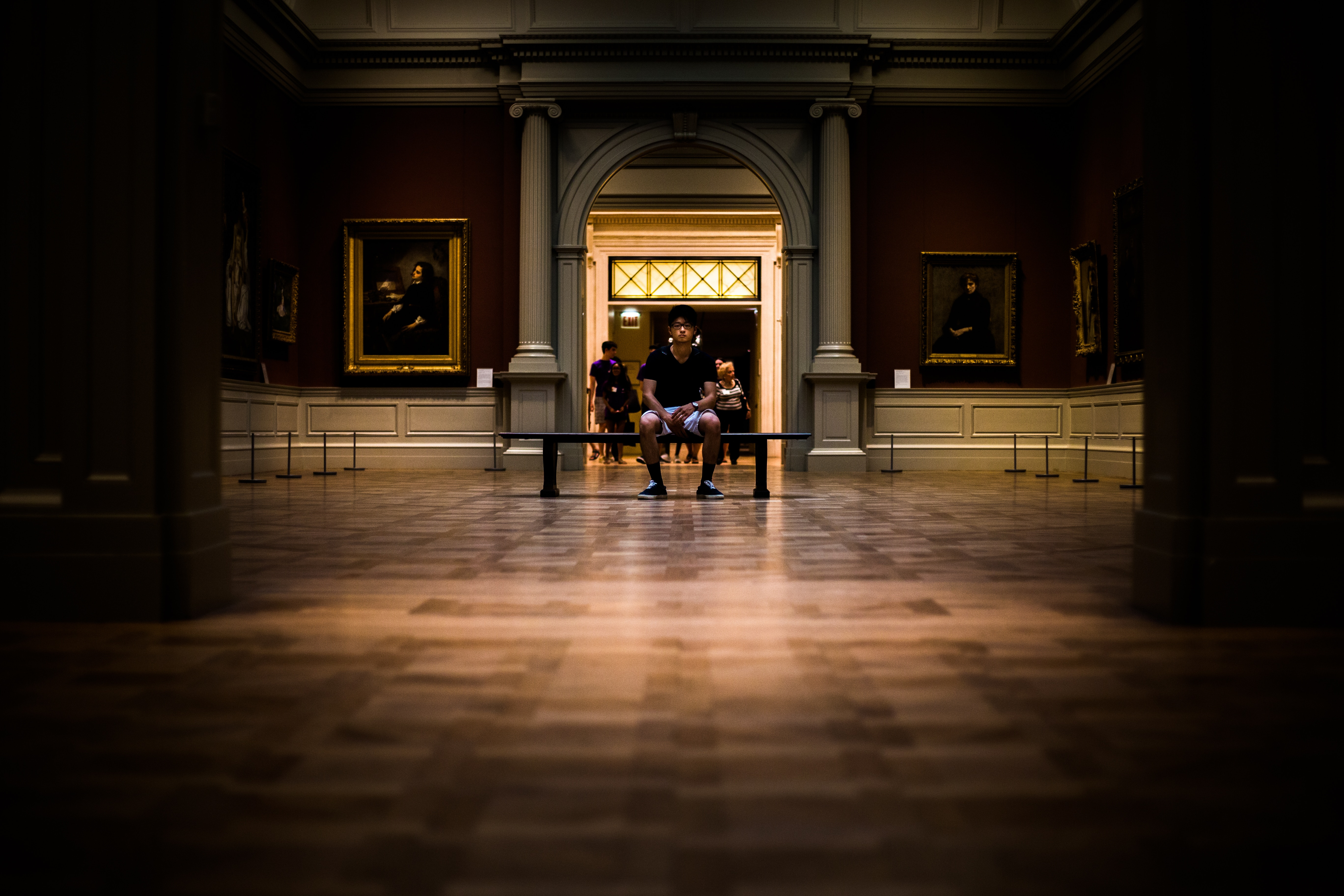 person sitting in art museum