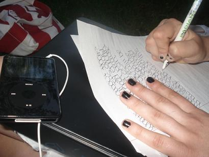 girl writing on notebook paper