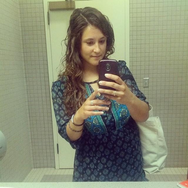 girl taking bathroom mirror selfie