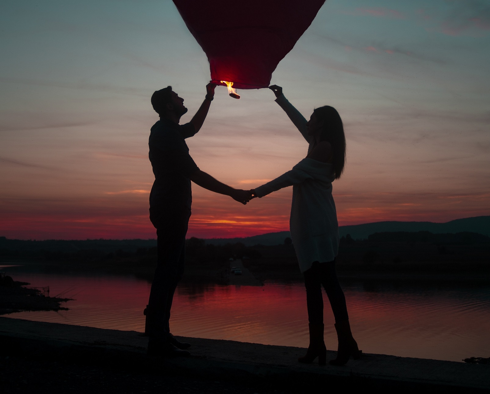 couple holding hot air balloon