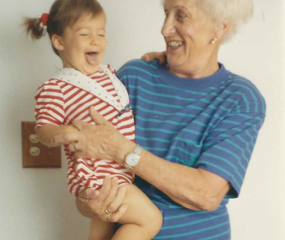 girl with her grandmother being silly