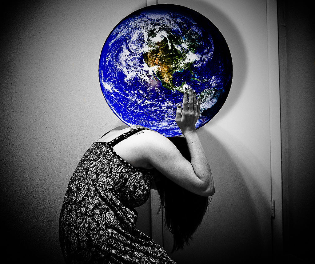 girl carrying the world on her shoulders