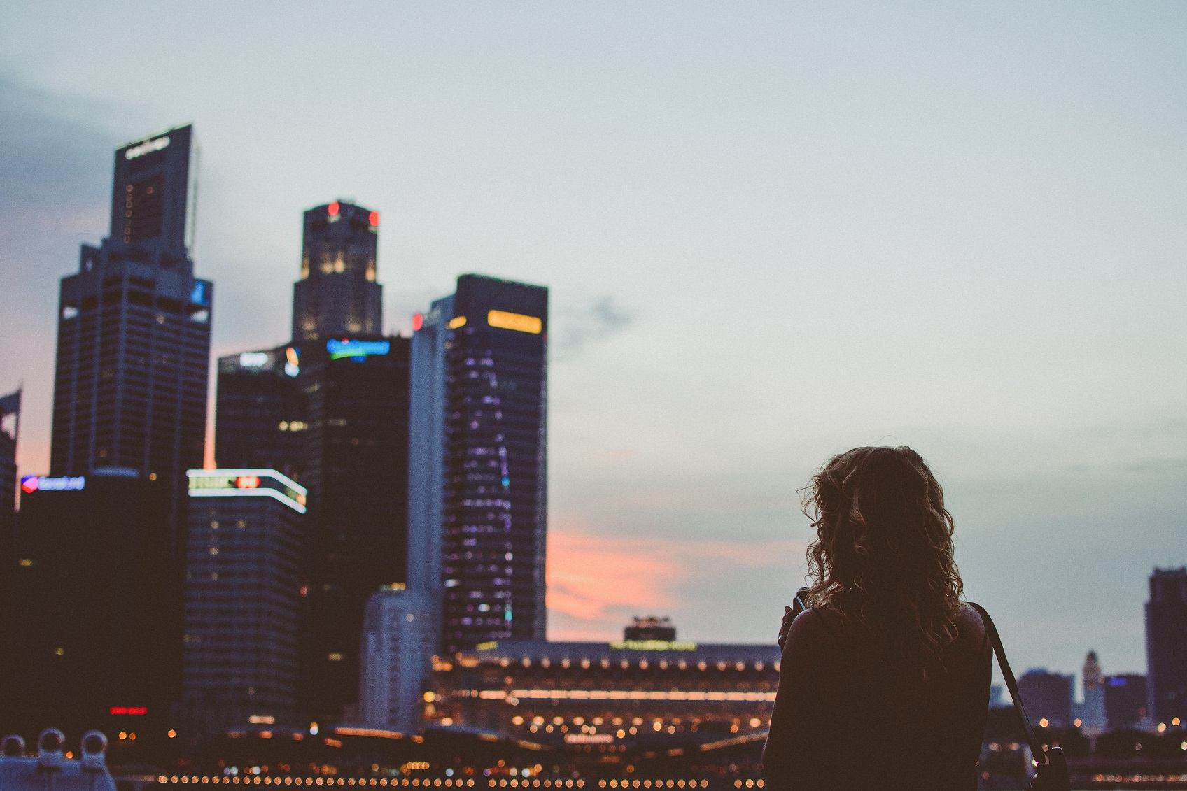 girl looking out at city skyline