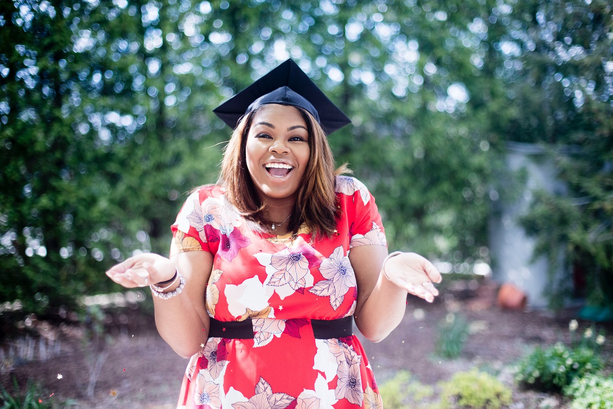 post-graduation girl with arms up