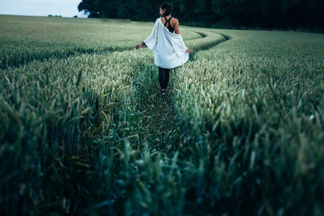 girl walking through cornfields