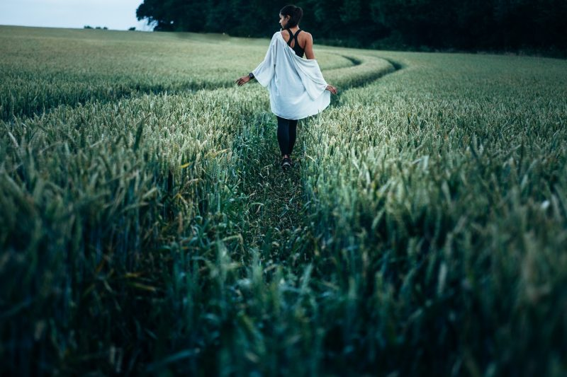girl walking through cornfields