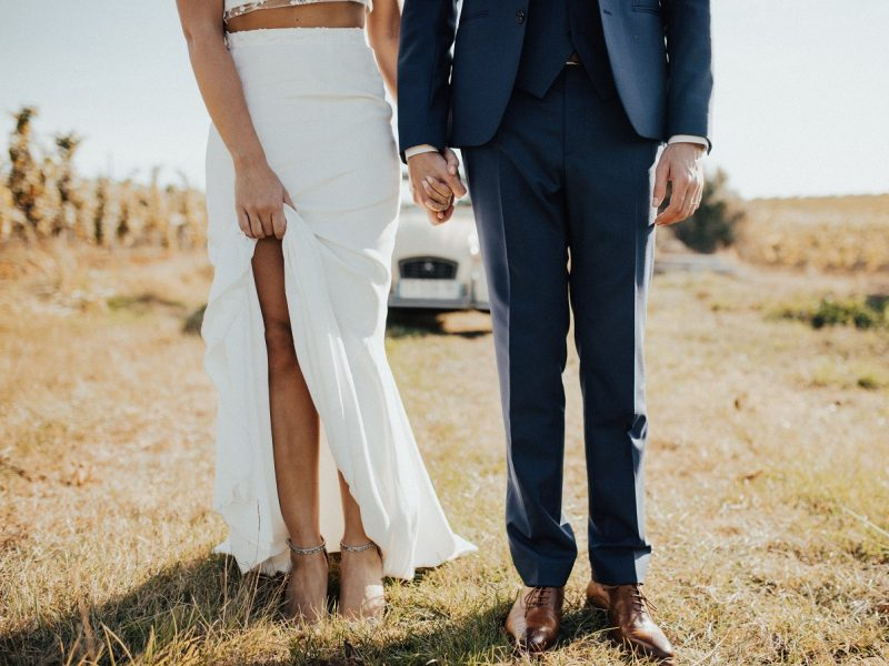 wedding couple standing in field