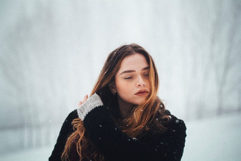 girl holding hair with eyes closed, you are wonderful and worthy