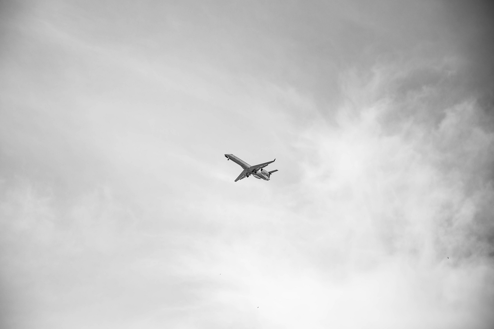 plane in the cloudy sky, cloudy days