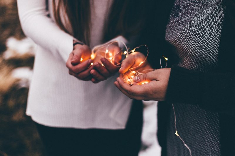 people holding lights in their palms