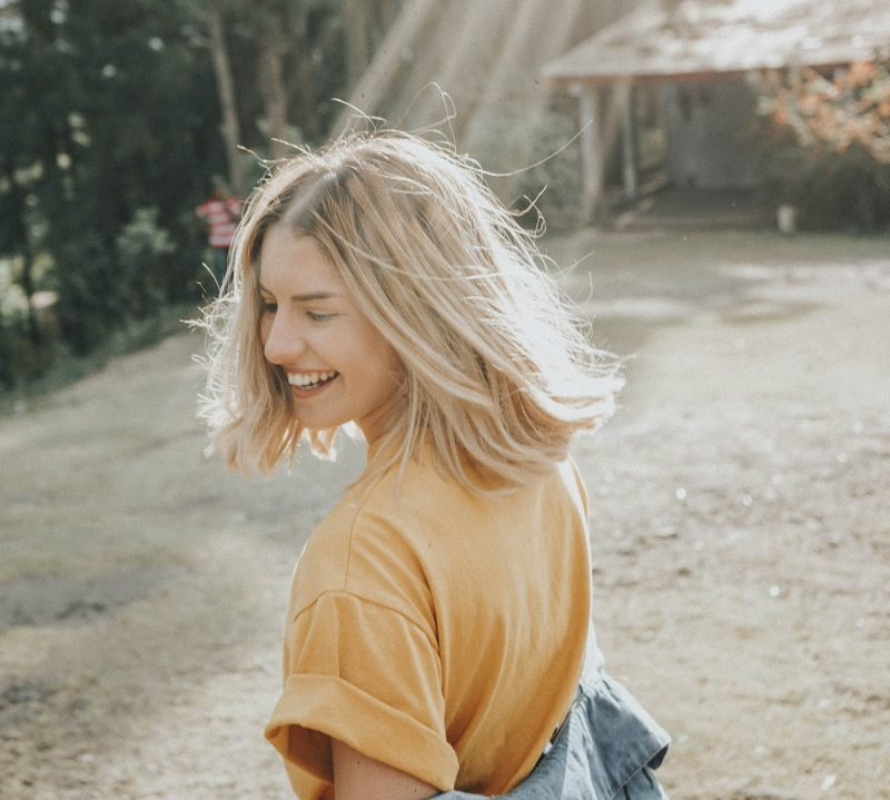 girl with sun in her hair dancing