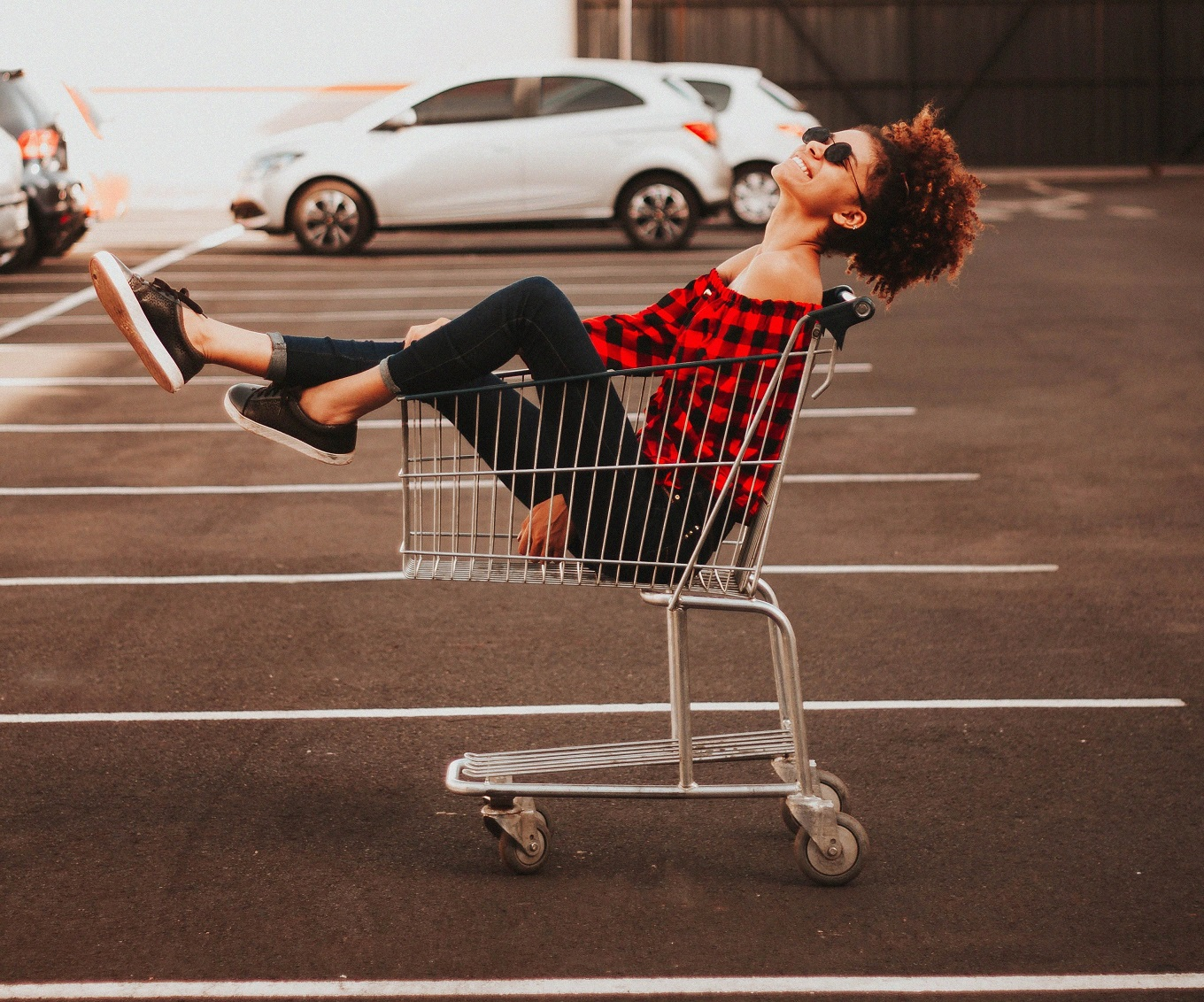 girl sitting in a shopping cart laughing, I believe in happiness
