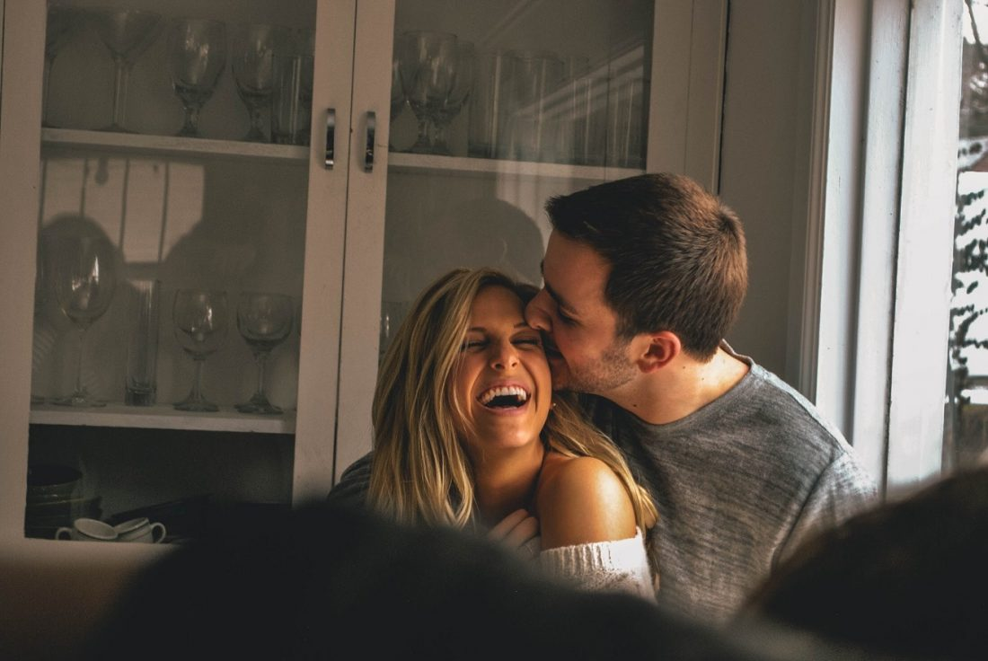 couple laughing, guy kissing forehead, i want every uncomfortable moment with you