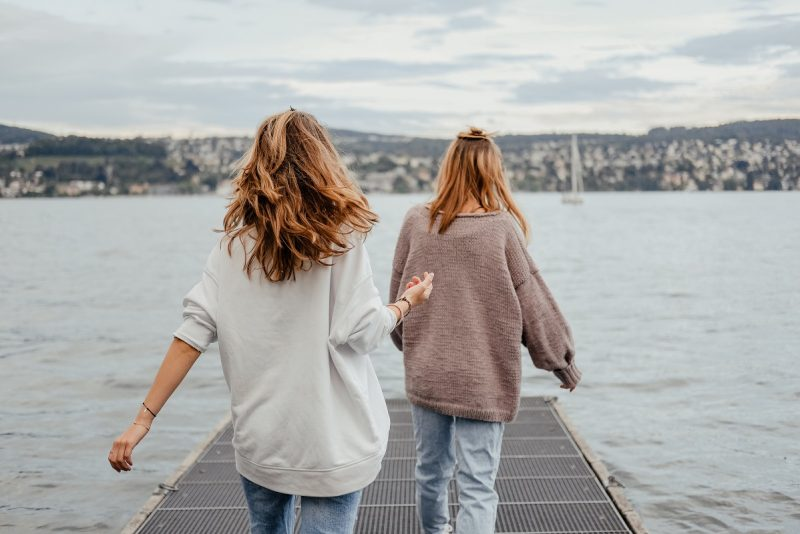 girls walking along pier, stop searching for happiness it's right here