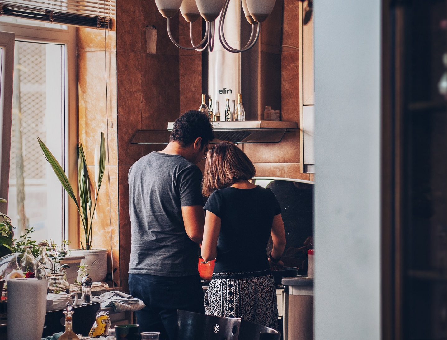 couple in kitchen standing side by side, ways to show love