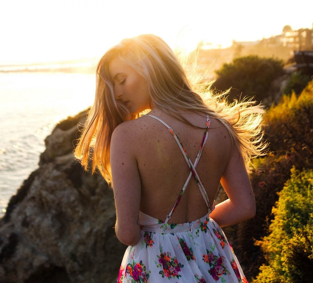 girl twirling her hair in sunset, walk in your identity