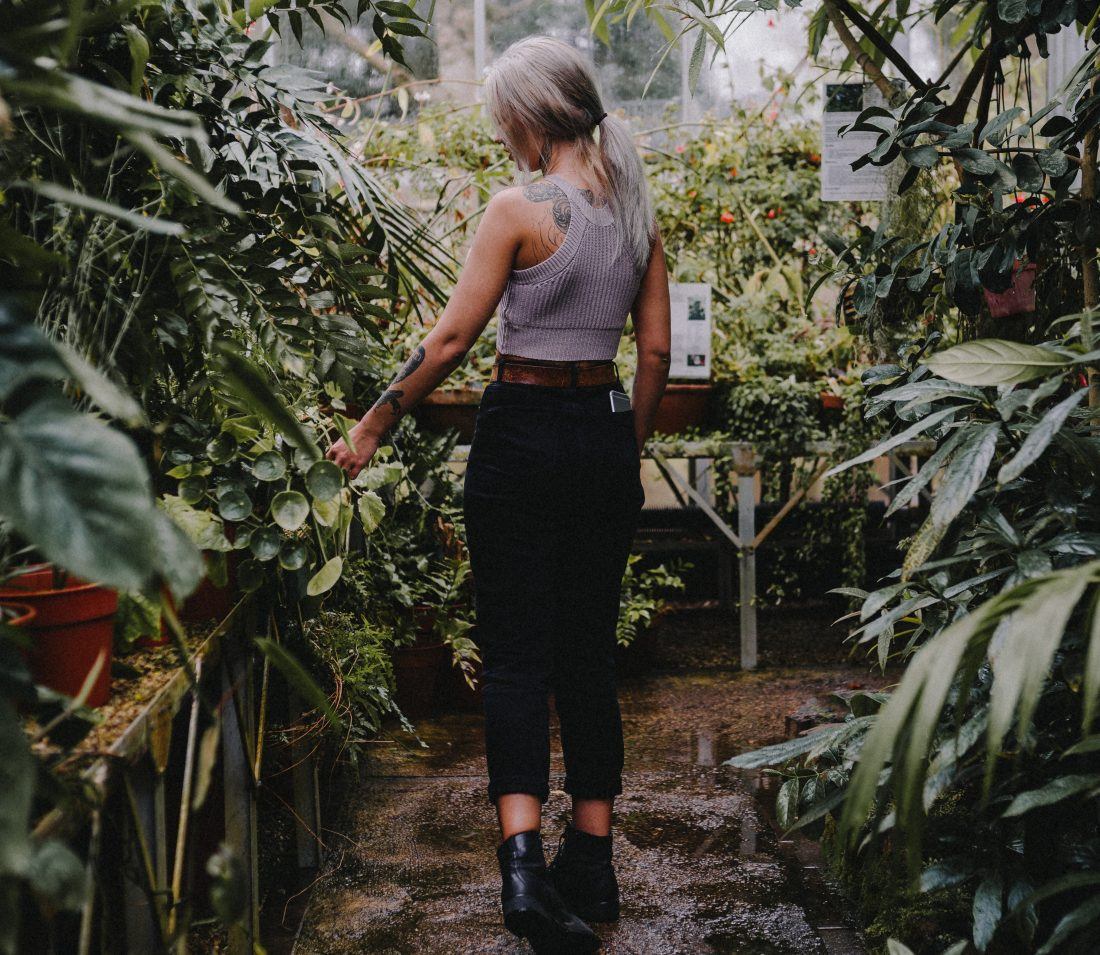 declutter your life, girl walking through garden
