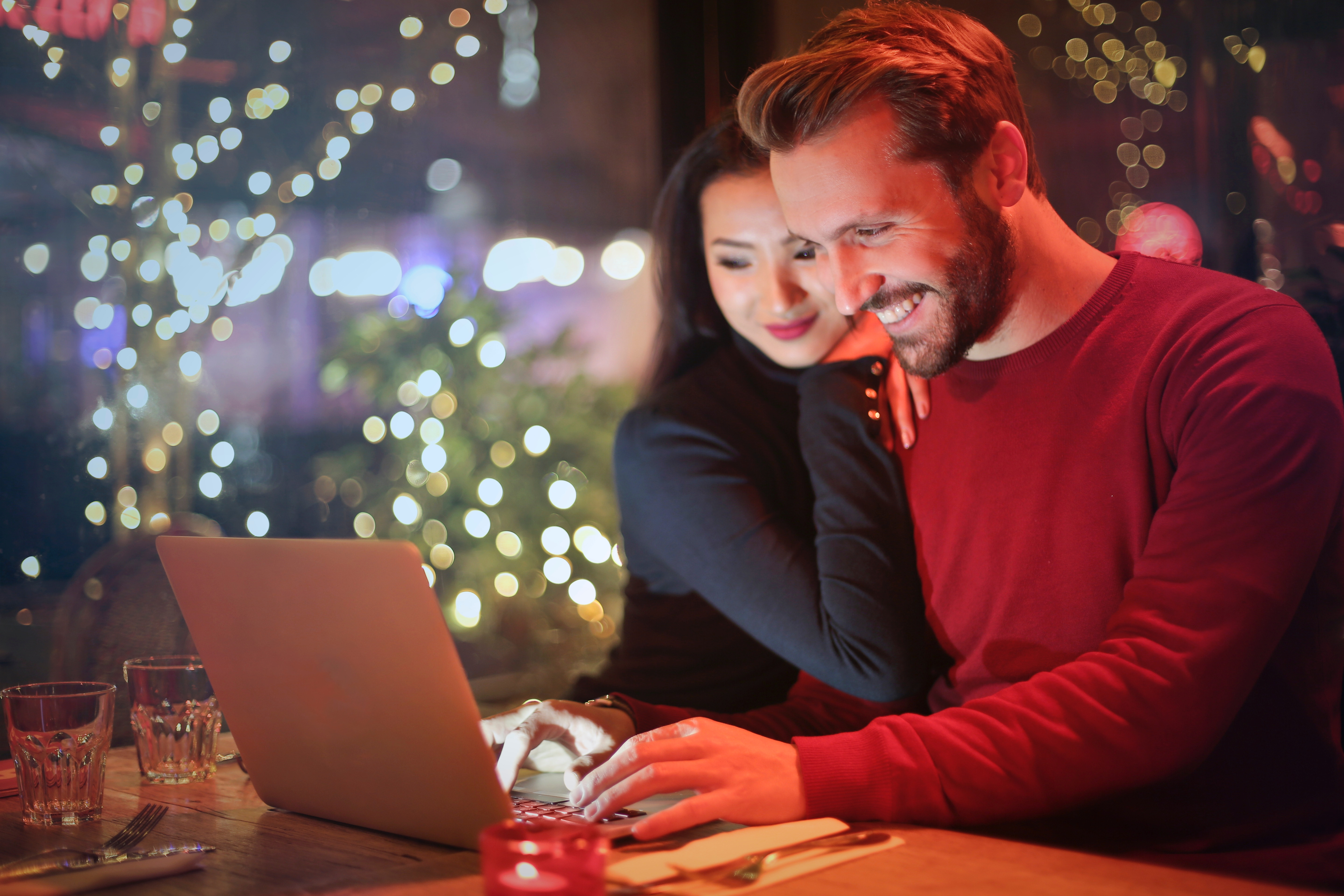 end of november reading list, happy couple looking at computer