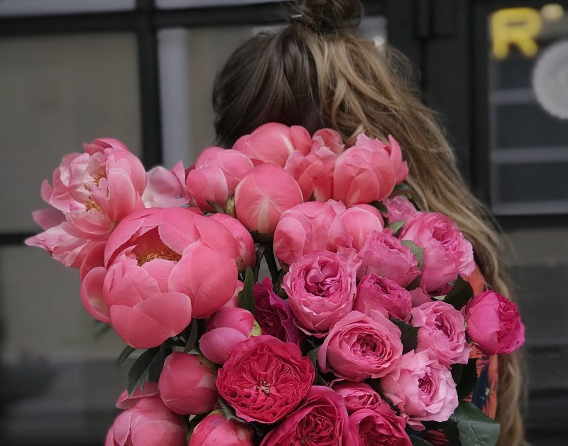 stop beating yourself up for being human, girl holding flowers