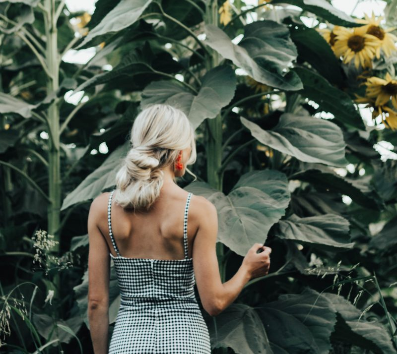 you don't have it all together, woman in front of sunflowers