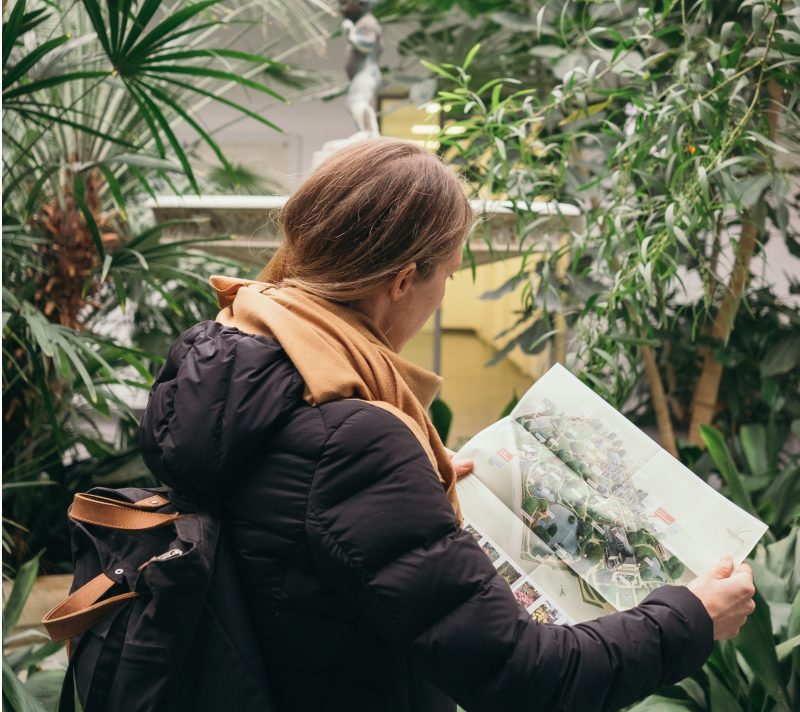 best gifts for travelers, woman holding map