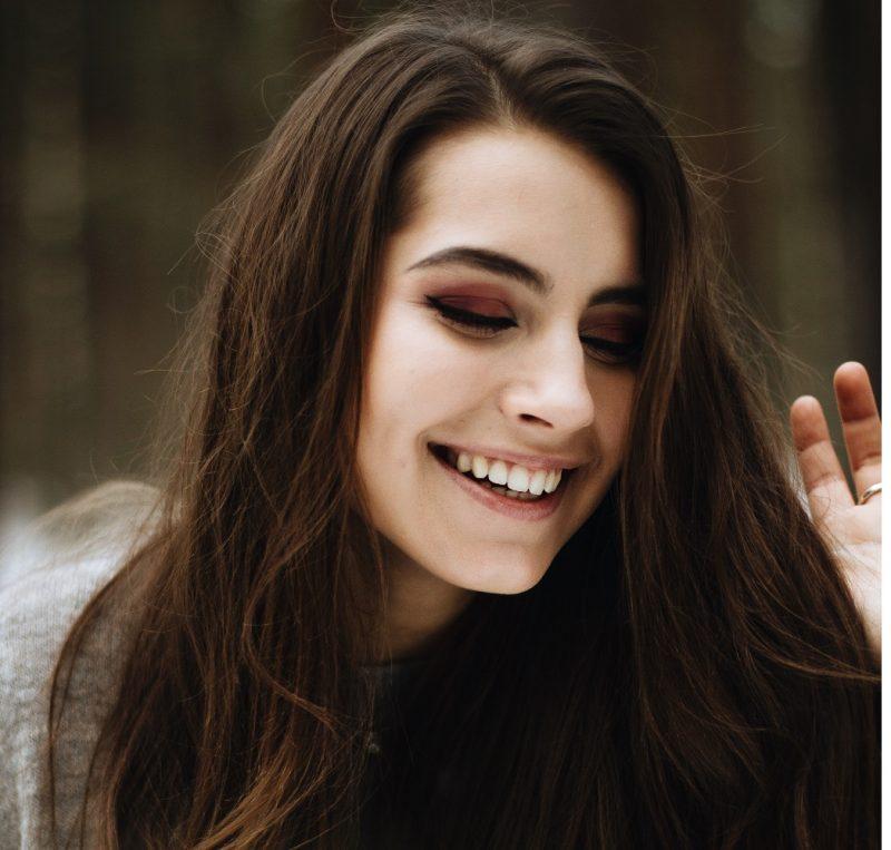 happy woman outside, celebrates life
