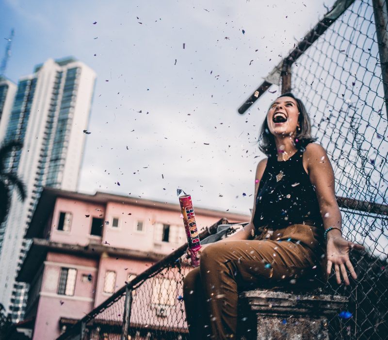 happy woman with confetti, how to create inner peace