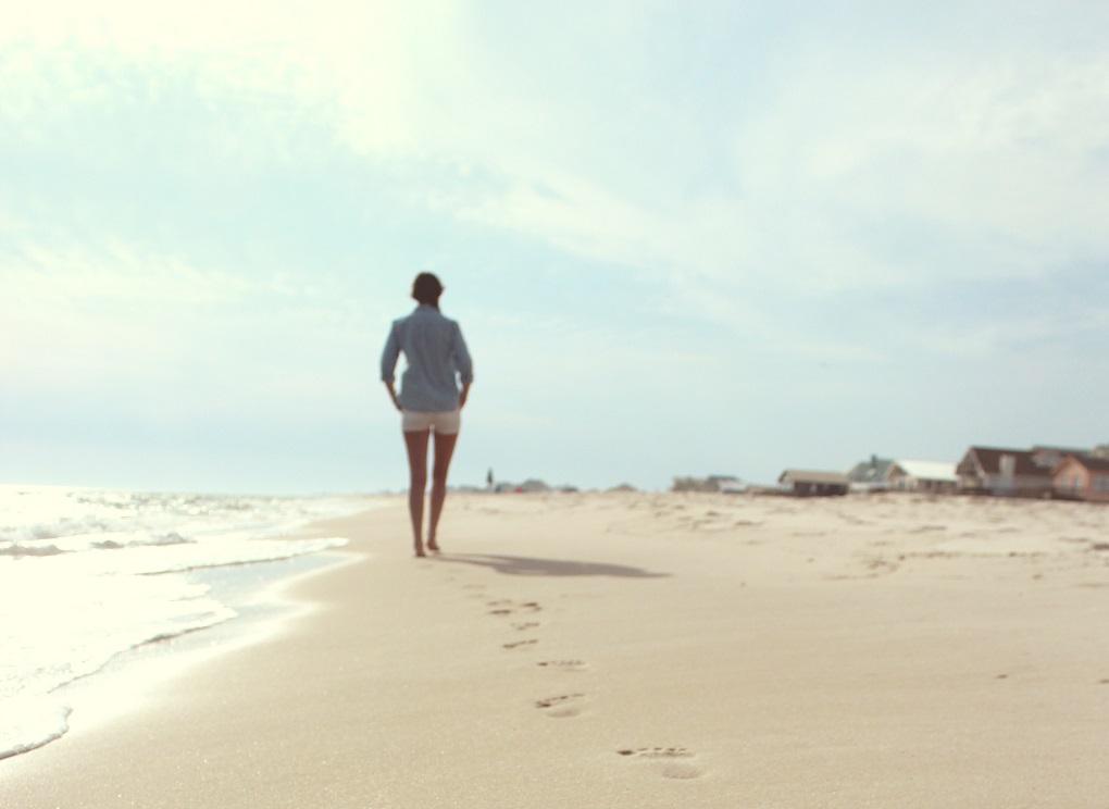 woman walking along beach, finding who I am