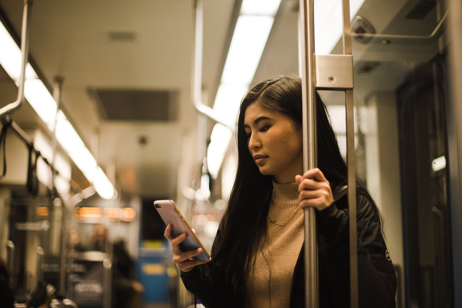 woman holding phone navigating through life