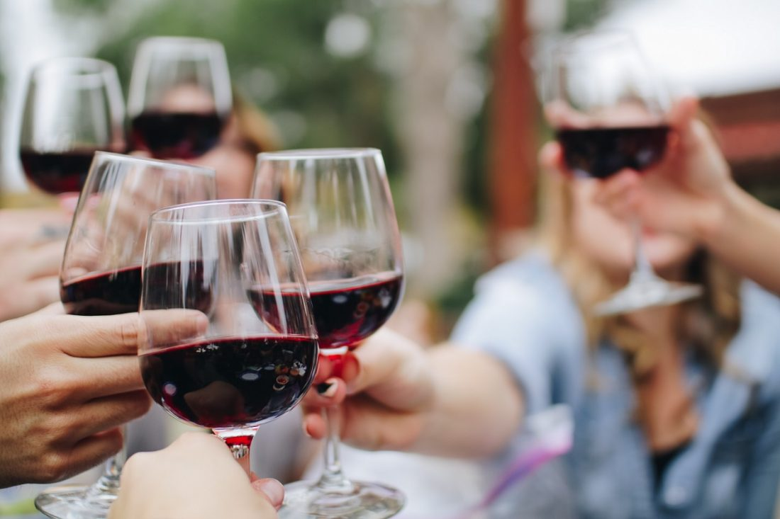 people holding out best wine pairings