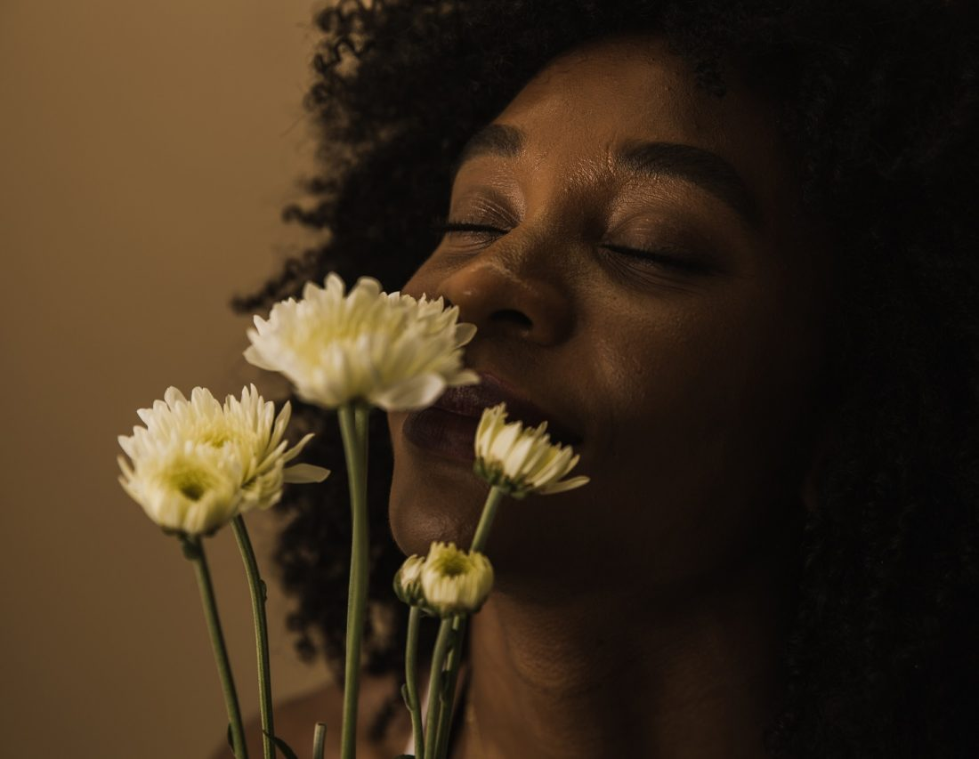 happy woman smelling flowers