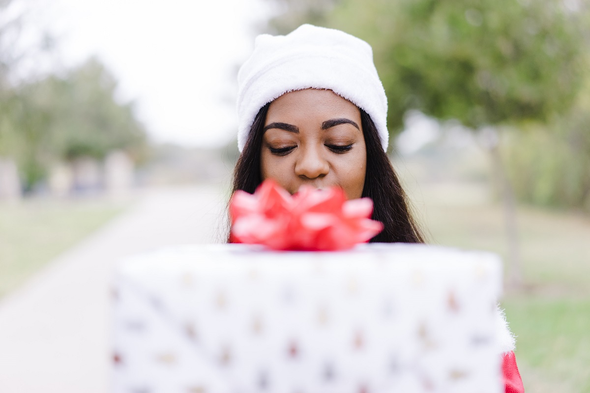 happy woman holding last-minute gifts for Christmas