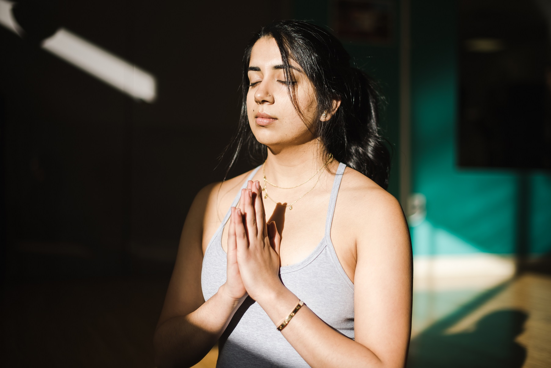 girl meditating finding ways to ease anxiety in stressful times